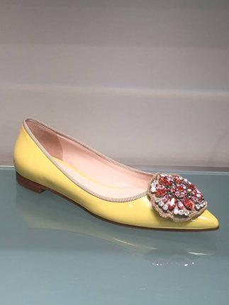 Ballerine gialle con fiore Prada